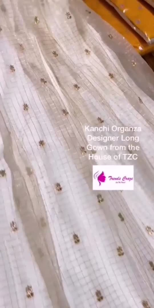 """Kanchi Organza Designer Long Gown.  Unique Color Combination with all over Zari Checks and Sequence work Butties.  Contrast Kanchi Weaving Border with Floral detailing. Contrast Raw Silk Designer Yoke with sequence work.  Available in   M - 38 L - 40 Xl - 42 Xxl - 44  Length 55""""  Inner Lining Attached. . . . . . . . . #arunacollection01 #2021 #partywear #sareelove #traditionalwear #indianstyle #sareestyle #sareedrapist #sareedraping #sareeindia#sareecollection #onlinefashion #onlineshopping  #fashiondesigner #fashionartist #shoppingdiares #gown #weddingseason #usa #gownfashion #reels #reelslove"""