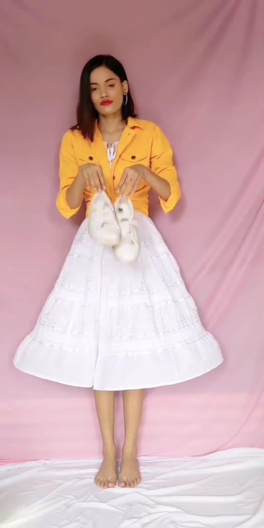 Styling white skater dress with yellow denim jacket