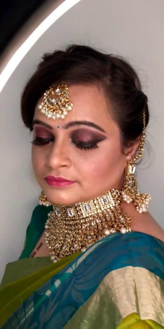 Check out more reels and visit profile to see more work..  Burgundy Somkey Eyemakeup look.. created for makeup tutorial.and to showcase heavy eyemakeup looks stunning and beautiful.  My beautiful model Ashwini  Photography @mr.kunigal  Jewellry @rent_bridal_jewellery   #smokey #smokey-eyes #makeupartist #bridalmakeup #youtuber #makeuptutorial #roposostar #roposo #bengaluru #eyemakeup #eyemakeuptutorial #bebridemakeup